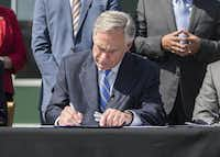 Gov. Greg Abbott got one of his priorities passed when state lawmakers OK'd fixes to the state's broken property tax system. Watchdog Dave Lieber says the changes improve the system. Here, Abbott signs the bill into law.(Ricardo Brazziell/Austin American-Statesman)