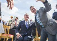 Nathaniel Mayfield takes a photo with Governor Greg Abbott after he signed a bill that limits property tax growth, Wednesday, June 12, 2019. (Ricardo Brazziell/Austin American-Statesman)