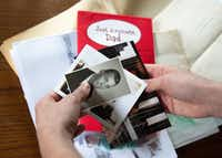 Janielle Kastner looks through old photos and cards belonging to her late father.(Lynda M. Gonzalez/Staff Photographer)