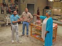 Ace Anderson (left), Leon Addison Brown and Liz Mikel star in <i>Penny Candy</i> at Dallas Theater Center. Trouble spreads among the characters as crack invades their Pleasant Grove neighborhood.(Karen Almond)