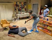 Rose (Claudia Logan, center) threatens neighbor Donnie (Jamal Sterling) as Jon-Jon (Esau Price) and Laura Mae (Liz Mikel) watch from the kitchen in <i>Penny Candy</i>.(Dallas Theater Center&nbsp;/Karen 'Almond)