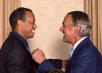 Tiger Woods greeted PGA of America CEO Seth Waugh during the champion's dinner for the 101st PGA Championship at the Bethpage Black course May 14 in Farmingdale, N.Y.(Montana Pritchard/PGA of America)