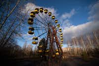 The faded yellow Ferris wheel in Pripyat's amusement park never gave a ride to a single child. The park was set to open the week after the explosion.(Chernobyl Tour/chernobyl-tour.com)
