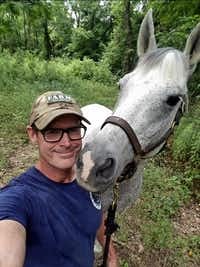 Veteran and Equest volunteer Jeff Hensley takes a selfie with his Equest horse, Tez, while riding in the Great Trinity Forest Wednesday.(Jeff Hensley)