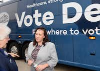 MJ Hegar, when she was the Democratic candidate for Texas Congressional District 31, listens to a constituent at the start of the Texas Democratic Party's Fair Shot Bus Tour on Wednesday Oct. 17, 2018.(Steve Lewis/Austin American-Statesman)