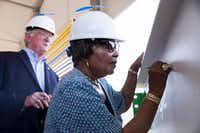 Midlothian mayor Richard Reno and U.S. Representative Eddie Bernice Johnson sign a steel bar during an announcement of Google's new data center in Midlothian on Friday.(Shaban Athuman/Staff Photographer)