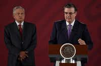 Mexican Foreign Minister Marcelo Ebrard, right, with Mexican President Andres Manuel Lopez Obrador during a news conference at the Palacio Nacional in Mexico City, on June 14, 2019.(ALFREDO ESTRELLA/AFP/Getty Images)