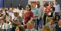 Anna Hill, president of the Dolphin Heights Neighborhood Association, at the microphone, and other concerned citizens share their thoughts with the board during a Fair Park Board special meeting to brief the community on the proposed privatization of the operations of Fair Park, held at the Hall of State in Fair Park in Dallas on Thursday, August 9, 2018. (Louis DeLuca/The Dallas Morning News)