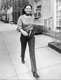FILE- In this undated file photo heiress and designer Gloria Vanderbilt walks down a New York street. Vanderbilt died on Monday, June 17, 2019, at 95, according to her son, CNN anchor Anderson Cooper.(AP)