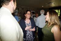 Paula Blackmon (center) talks with John Botefuhr and Anne Maurer during her runoff watch party June 8 at Local Traveler in Dallas. Blackmon defeated Erin Moore in East Dallas' District 9.(Special Contributor/Lawrence Jenkins)