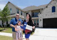 Scott and Marie Bailey, with their daughter Alexandra, in front of their home at Windsong Ranch in Prosper on Tuesday, They moved in just two weeks ago.(Vernon Bryant/Staff Photographer)
