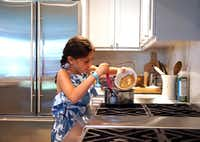 Sophie Massad (8) adds ingredients for granola bars at her home in Dallas.(Lawrence Jenkins/Special Contributor)