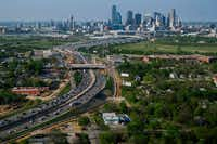 Aerial view of I-35  passing under Colorado Avenue in Oak Cliff and heading toward downtown on Thursday, April 4, 2019, in Dallas.(Smiley N. Pool/Staff Photographer)