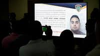 Journalists photograph a projected image of a man identified by authorities as Victor Hugo Gomez Vasquez, suspected mastermind of the attack that wounded former Boston Red Sox slugger David Ortiz in the Dominican Republic.&nbsp;<br>(Roberto Guzman/AP)