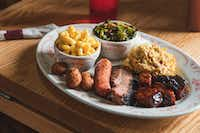 """Midwood Smokehouse in Charlotte is known for Texas-style brisket, St. Louis ribs and Carolina barbecue.&nbsp;(<p>R<span style=""""font-size: 1em; background-color: transparent;"""">é</span><span style=""""font-size: 1em; background-color: transparent;"""">my Thurston</span></p>/Midwood Smokehouse)"""