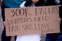 "<p><span style=""font-size: 1em; background-color: transparent;"">About 300,000 workers don't have paid sick leave in Dallas, according to a study by the Institute for Women's Policy Research, which relied on 2016 U.S. census data — information reflected on a sign held by a girl at Thursday's rally at Dallas City Hall.</span></p>(Shaban Athuman/Staff Photographer)"