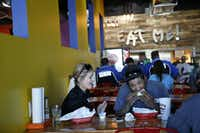 Bridgette Johns (left) and Devon Manning eat at Fuzzy's Taco Shop in Frisco March 1, 2016. (Nathan Hunsinger The Dallas Morning News)(Nathan Hunsinger/Staff Photographer)
