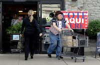 Shoppers enter and exit a grocery story which is also serving as a polling site for the Texas primary elections, Tuesday, March 6, 2018, in Austin, Texas(Eric Gay/AP)