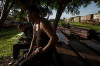 Honduran migrants sit on discarded rail tracks as they wait for a train heading north, in Arriaga, Mexico, on June 24, 2019. Mexican authorities are reinforcing efforts to deter Central Americans and others from crossing the country to reach the United States, detaining migrants in the south and stationing National Guardsmen along the Rio Grande in the north.(Oliver de Ros/The Associated Press)