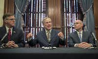 Gov. Greg Abbott announces a deployment of National Guard troops to the Texas-Mexico border at a news conference at the Capitol, Friday June 21, 2019 in Austin, Texas. Listening are Lt. Gov. Dan Patrick, left, and House Speaker Dennis Bonnen.(Jay Janner/AP)