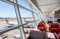 Seating along a 500-foot-long wall of windows offers panoramic views of the tarmac in the new American Airlines Flagship Lounge on Monday, May 13, 2019 in Terminal D at DFW Airport in Grapevine, Texas.(Jeffrey McWhorter/Special Contributor)