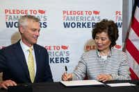 U.S. Transportation Secretary Elaine Chao (right) joins American Airlines President Robert Isom as the airline signed on to the White House's Pledge to America's Workers by committing to create 22,000 training and education opportunities.(Lynda M. Gonzalez/Staff Photographer)
