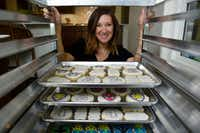 Cale Pruit of Tesoro Baking Co. with several trays of cookies she baked and decorated at her home in Dallas on June 13, 2019.(Ben Torres/Special Contributor)