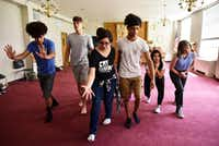 Laurel Mora, 17, (center left) and Matthew Gardara, 17, (center right) lead a group of high school actors from Cry Havoc Theater Company during a rehearsal of&nbsp;<i>Crossing the Line</i>, based on research the troupe conducted on the immigration controversy at the Texas-Mexico border.(Ben Torres/Special Contributor)