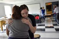 Emma Burkey, 16, (right) hugs Cicsy Rojas, 17, during a rehearsal of <i>Sex Ed</i>.(Ben Torres/Special Contributor)