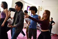 Ollin Barraza Fernandez, 18, left, Landon Robinson, 15, and Angie Hogue, 17, right, rehearse Cry Havoc Theater Company's <i>Crossing the Line</i>.(Ben Torres/Special Contributor)