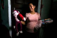Rosa Ramirez sobs as she shows journalists toys that belonged to her nearly 2-year-old granddaughter Valeria in her home in San Martin, El Salvador, Tuesday, June 25, 2019. The drowned bodies of Ramirez's son, 25-year-old Oscar Alberto Martinez Ramirez and his daughter were located Monday morning on the banks of the Rio Grande, a day after the pair were swept away by the current when the young family tried to cross the river to Brownsville, Texas. Her daughter-in-law Tania Vanessa Avalos, 21, survived.(Antonio Valladares/AP)