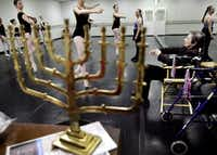 A menorah sits on the piano in the City Ballet dance studio in Dallas as Denise Brown (right) gave bits of advice to some of the dancers. (Mona Reeder /Staff Photographer)