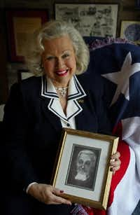 Dallas native Pat Spackey  holds a portrait of her great-great grandfather, Dr. Charles Bellinger, who was a major figure in the Texas Revolution and is often credited with having designed the Texas flag.(2003 File Photo/Staff)