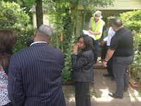 Council member Carolyn King Arnold (center) and some 20 city staffers met at Diane Wynn's house Thursday morning to discuss how much of her land the city needs for the improvements coming to The Bottom.(Robert Wilonsky/Staff)