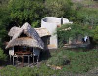 Ol Donyo Lodge offers luxury star bed accommodations in the Chyulu Hills, between two of Kenya's national parks. (Great Plains Conservation/Tribune News Service)