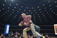 Professional wrestlers Kazuchika Okada (top, front) and Kenny Omega face off in Japan's version of WWE.(AXS TV/TV Asahi)