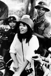 In this July 1972 file photo, American actress and activist Jane Fonda is surrounded by soldiers and reporters as she sings an anti-war song near Hanoi during the Vietnam War.(NIHON DENPA NEWS/AP)