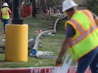 """<p><span style=""""font-size: 1em; background-color: transparent;"""">Crews worked last year along Midway Road to replace gas lines after one house exploded and two others burned in northwest Dallas. Atmos replaced the entire distribution system there after it was deemed """"too dangerous to operate,"""" records show.&nbsp;</span></p>(File Photo&nbsp;/Staff)"""