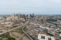A view looking from south to the north of downtown Dallas. Shown are I-30 (foreground, bottom left, running left to right) and Highway 345 (running from bottom left to top center, south to north) in Dallas on Friday, June 14, 2019. The Coalition for a New Dallas wants to tear down the highway and replace it with a mixed-income, mixed-use neighborhood.(Shaban Athuman/Staff Photographer)