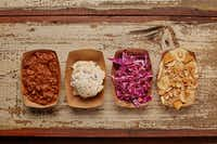 Side dishes include pinto beans (left) and baked potato salad (second from left) at Heim Barbecue.(Jason Kindig/Heim Barbecue)