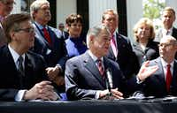 Gov. Greg Abbott (center), Lt. Gov. Dan Patrick (left), Speaker of the House Dennis Bonnen (right) and other lawmakers attended a joint news conference to discuss teacher pay and school finance at the Texas Governor's Mansion in Austin on May 23, 2019.(Eric Gay/The Associated Press)