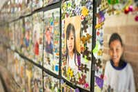 Pictures of DISD refugee summer program participants hang in the hallway at Sam Tasby Middle School in Dallas on Wednesday, June 26, 2019.(Shaban Athuman/Staff Photographer)