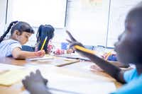 """<p><span style=""""font-size: 1em; background-color: transparent;"""">Shar Reh, 7, left, writes in her journal as Ajuda Nyabu, 7, right, concentrates during DISD refugee summer program at Sam Tasby Middle School in Dallas on Wednesday, June 26, 2019. The summer camp is designed to help refugee students improve their English another social skills, as well as meet other students who are from other countries too.</span></p>(Shaban Athuman/Staff Photographer)"""