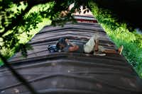 A Honduran migrant rides a freight train on his way north, in Salto del Agua, Mexico, Tuesday, June 25, 2019. Mexico has deployed 6,500 National Guard members in the southern part of the country, plus another 15,000 soldiers along its northern border in a bid to reduce the number of migrants traveling through its territory to reach the U.S.(Marco Ugarte/The Associated Press)