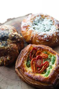 A ham and Gruyere croissant, an asparagus and tomato Danish with roasted garlic-pecorino bechamel, and a roasted mushroom and goat cheese Danish with kale pesto — all cooked by Matt Bresnan.(Lynda M. Gonzalez/Staff Photographer)