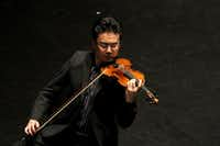 Violinist Jing Wang of Jing Wang and Friends performed in 2013 at the Dallas City Performance Hall in Dallas. The concert was part of the 33rd Annual Basically Beethoven Festival.(File Photo/Staff)