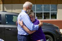 Former vice president and 2020 presidential candidate Joe Biden consoles Belinda Scavone as she speaks about the recent passing of her husband after a campaign event on July 4 in Marshalltown, Iowa. The 2020 Iowa Democratic caucuses will take place on Feb. 3, 2020.(Joshua Lott/Getty Images)