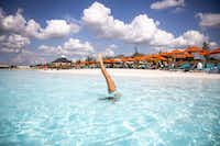 Alexis Domin performs a handstand in the water at the Crystal Lagoon.(Shaban Athuman/Staff Photographer)