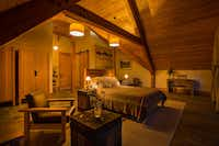 An upstairs bedroom offers a relaxing environment for guests at the Minam River Lodge.(Evan Schneider/Minam River Lodge)