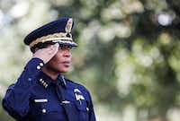 Dallas Police Chief U. Renee Hall salutes for the national anthem during an unveiling ceremony for a memorial in honor of the five officers who died on July 7, 2016 at the Jack Evans Police Headquarters in Dallas on Monday, July 8, 2019.(Ryan Michalesko/Staff Photographer)